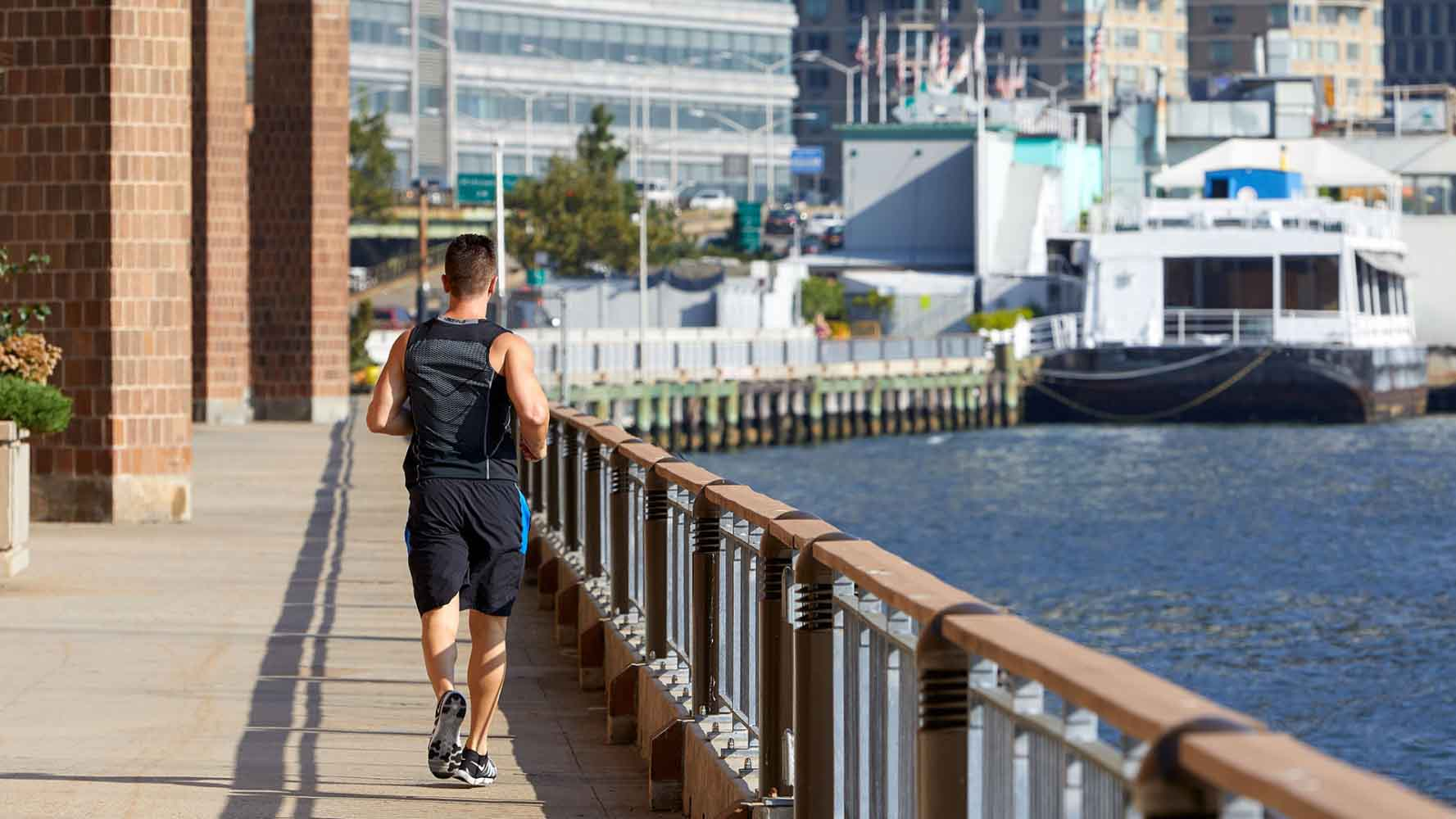 Man running by East River